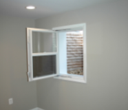 Compact Egress Window Open – in a Bedroom