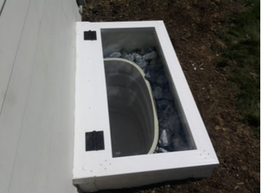 Tempered Glass Hinged Cover around a Galvanized Steel Well