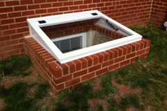 Tempered Glass Cover on a Brick Egress Well