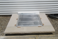 Hinged Aluminum Egress Well Grate on Fabricated Egress Well