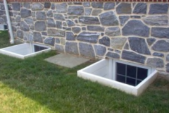 "Two 42"" wide Deluxe Stac-it Egress Wells"