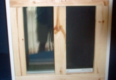 Sliding basement egress window view of wood bracing