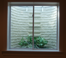Sliding basement egress window installed inside view