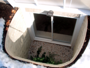 Sliding basement egress window installed outside view