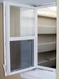 A REDI-EXIT® In-swing Egress Window