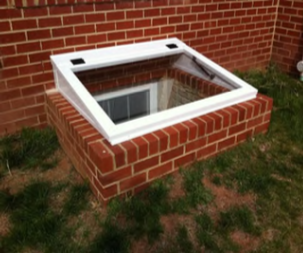 REDI-EXIT® Deluxe Custom Cover on a fabricated brick egress well